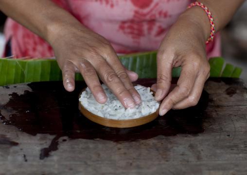 Khmu minority woman making rice, Houei xay, Laos