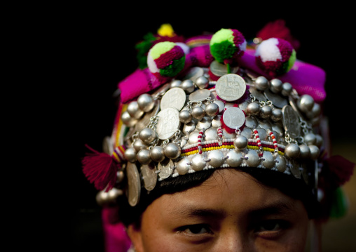 Akha minority woman with traditional headdress, Muang sing, Laos
