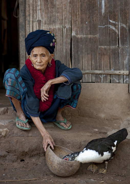 Yao minority old woman feeding ducks, Ban xay leck, Laos