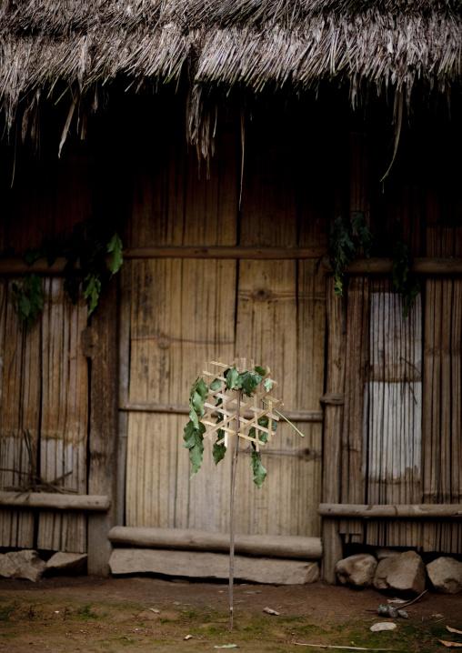 Hmong house with shaman warning sign, Muang sing, Laos