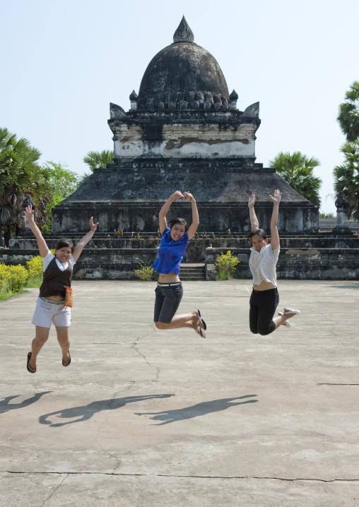 Girls jumping, Vat visunarat, Luang prabang, Laos