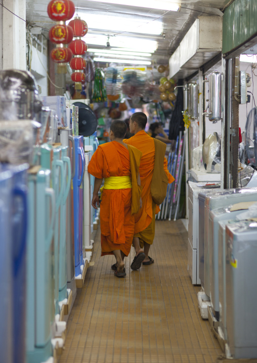 Monks inside an electronic shop, Vientiane, Laos