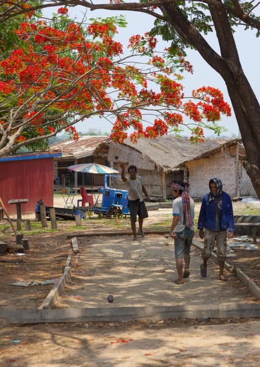 Men playing french petanque, Thakhek, Laos