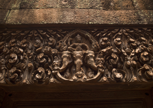 Detail of carvings on lintel above entrance to upper level sanctuary of wat phu, Champasak, Laos
