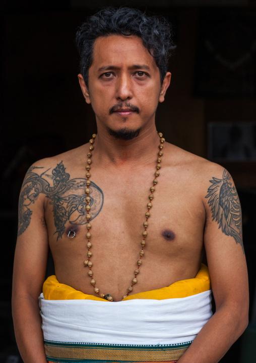 Portrait Of An Hindu Devotee With Tattoos In Annual Thaipusam Religious Festival In Batu Caves, Southeast Asia, Kuala Lumpur, Malaysia