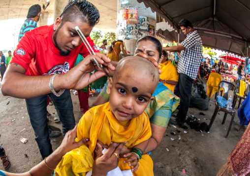 Child Being Shaved With A Razor In Annual Thaipusam Religious Festival In Batu Caves, Southeast Asia, Kuala Lumpur, Malaysia