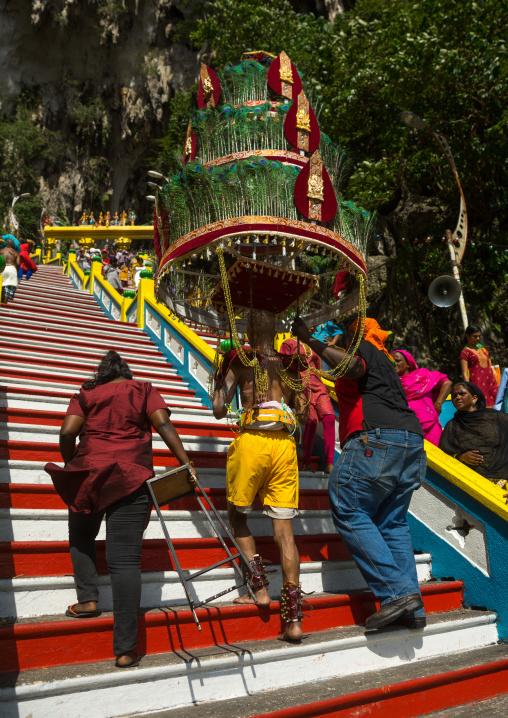Devotee Kavadi Bearer Climbing Stairs At Thaipusam Hindu Religious Festival In Batu Caves, Southeast Asia, Kuala Lumpur, Malaysia