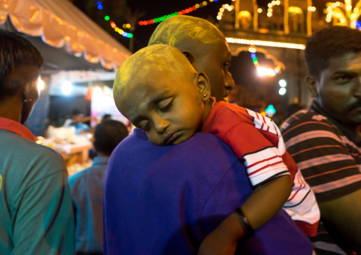 Portrait Of A Child Sleeping On His Father Shoulder In Batu Caves In Annual Thaipusam Religious Festival, Southeast Asia, Kuala Lumpur, Malaysia