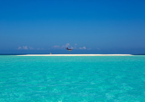 Seaplane Arriving At Soneva Fushi Hotel, Baa Atoll, Maldives