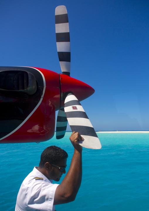 Maldivian Air Taxi Seaplane Pilot, Baa Atoll, Maldives