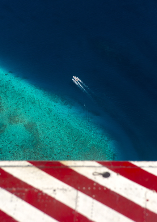 Seaplane Flying Over An Atoll And A Speed Boat, Male, Maldives