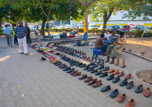 Man Selling Shoes In The Street, Maputo, Mozambique