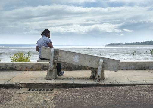 Woman In Front Of The Sea Sitting On A Broken Bench, Inhambane, Mozambique