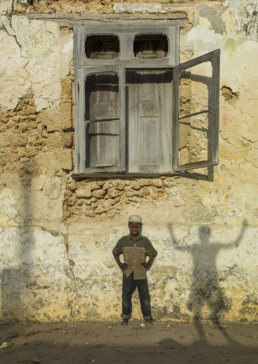 Kid Standing In Front Of An Old Window, Ibo Island, Mozambique
