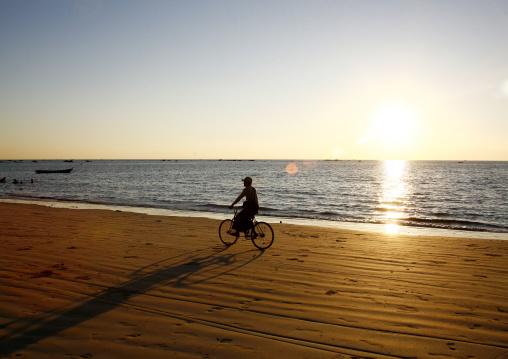 Man on a bike in ngapali beach, Myanmar