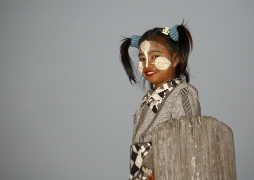 Girl with thanaka on cheeks, U bein bridge, Myanmar