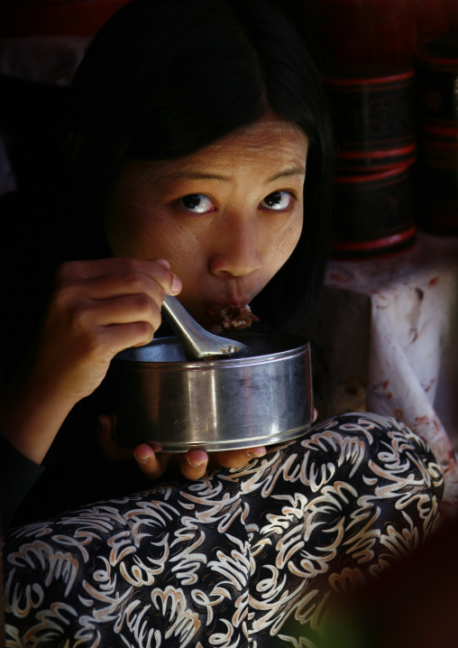 Woman eating in bagan, Myanmar