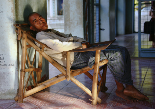 Man sleeping on a long chair, Bagan, Myanmar