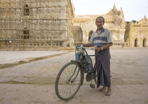 Man with a bicycle inside  in ananda paya, Bagan, Myanmar