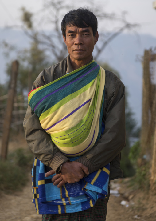 Father holding his baby, Mindat, Myanmar