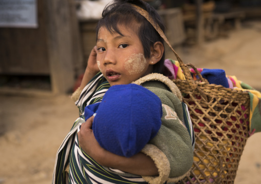 Young gilr holding a baby, Mindat, Myanmar