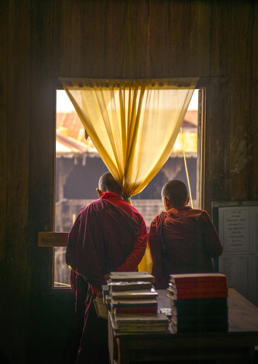 Novices monks looking thru a window, Inle lake, Myanmar