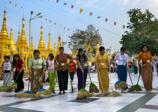 Women and men sweeping the shwedagon pagoda, Yangon, Myanmar