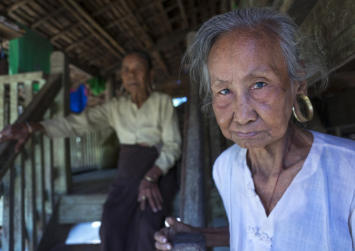Old women with huge ear rings, Mrauk u, Myanmar