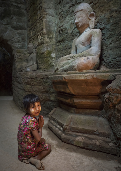 Little girl praying inside kothaung temple, Mrauk u, Myanmar