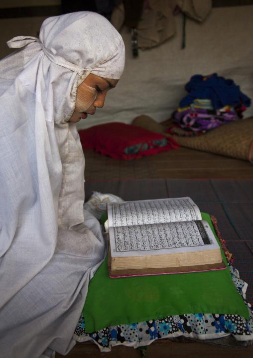 Rohingya woman praying, Thandwe, Myanmar