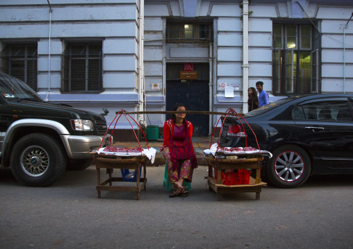 Woman Selling Food Between Two Luxury Cars In The Street,  Yangon, Myanmar