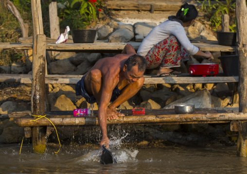Man washing himself, Inle lake, Myanmar
