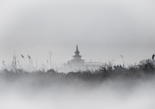 Fog surrounding a temple, Inle lake, Myanmar
