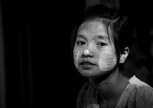 Girl with thanaka on cheeks, Ngapali, Myanmar