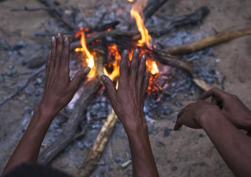 Bushman Hands Around A Fire, Tsumkwe, Namibia