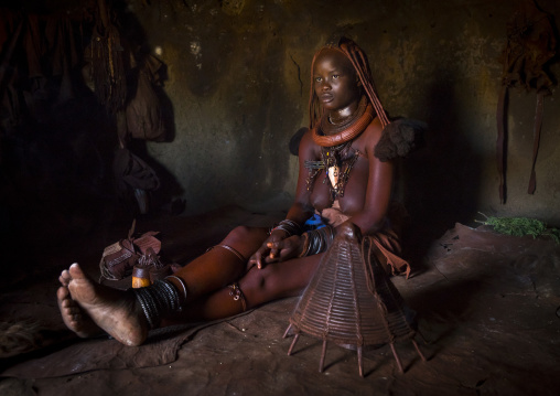 Himba Woman Using Incense To Purify Herself And Her Clothes, Epupa, Namibia