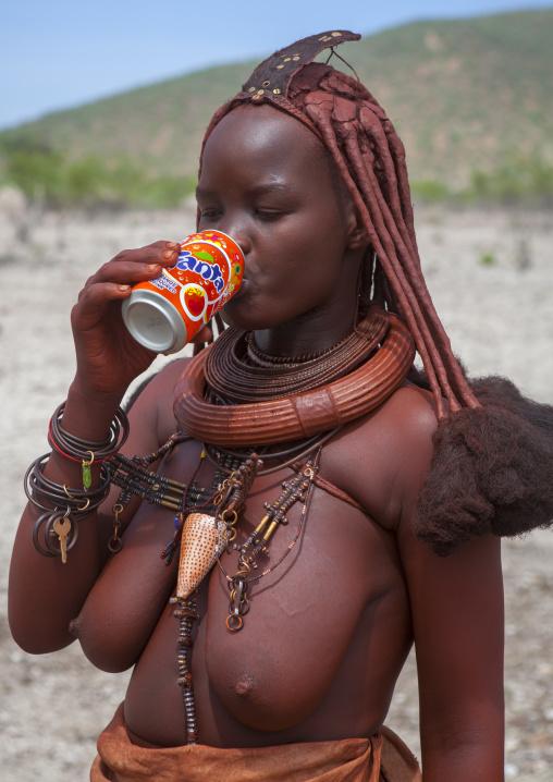 Bare Breasted Himba Woman Drinking Fanta, Epupa, Namibia