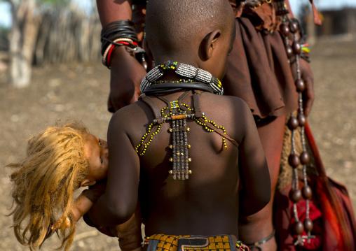 Himba Child Holding A Doll, Epupa, Namibia