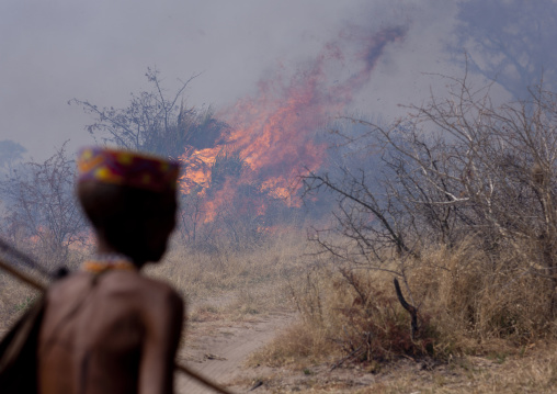 San Man In Front Of A Fire In The Bush, Namibia