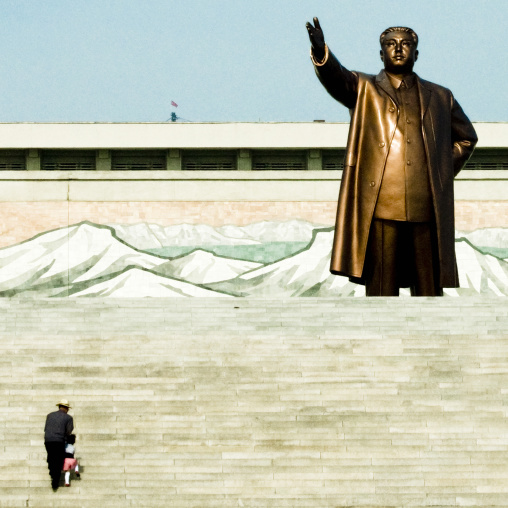 North Korean father and his son climbing the stairs leading to the statue of Kim il Sung in Mansudae Grand monument, Pyongan Province, Pyongyang, North Korea