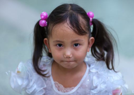 Portrait of a North Korean girl with plaits, Pyongan Province, Pyongyang, North Korea