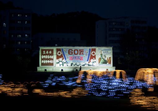 North Korean propaganda billboard for the celebration of the 60th anniversary of the regim, Pyongan Province, Pyongyang, North Korea