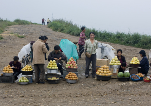North Korean people selling fruits in a market in the countryside, North Hwanghae Province, Sariwon, North Korea