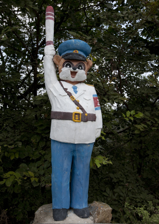 Funny statue of a North Korean traffic security officer in white unform in a park, Pyongan Province, Pyongyang, North Korea