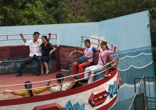 North Korean people enjoying an attraction in Taesongsan funfair, Pyongan Province, Pyongyang, North Korea