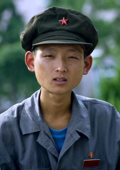 Skinny North Korean young man with a cap, Pyongan Province, Pyongyang, North Korea