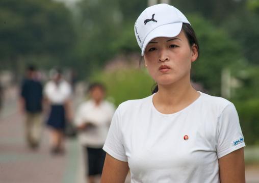 Portrait of a North Korean woman wearing a Puma cap, Pyongan Province, Pyongyang, North Korea