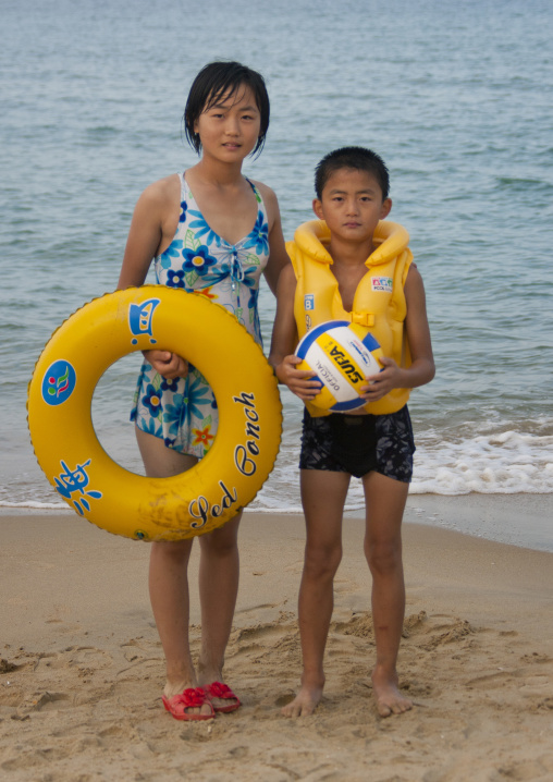 North Korean children on a beach with rubber ring and ball, North Hamgyong Province, Chilbo Sea, North Korea