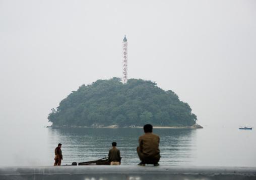 North Korean people sitting and looking at seaside island, South Hamgyong Province, Hamhung, North Korea