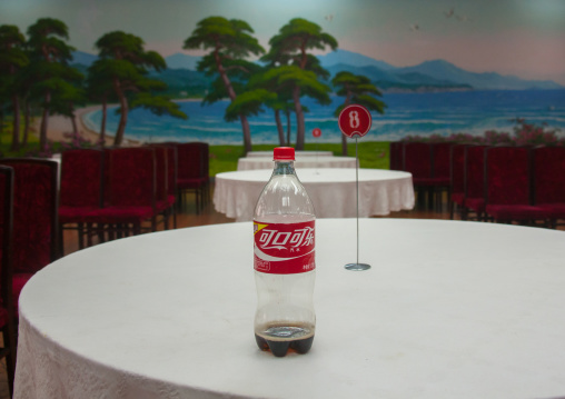 Chinese coca cola bottle on the table of an empty restaurant, South Hamgyong Province, Hamhung, North Korea